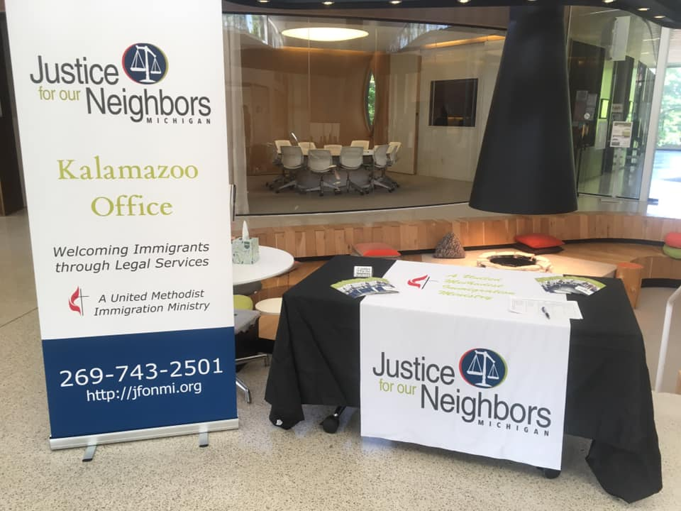 Justice Neighbord signage and information table